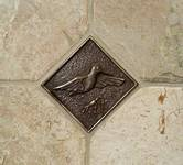 custom bronze hummingbird tile